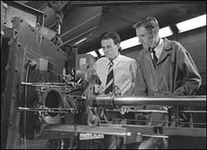 Physicist Eugene Gardner, right, at work with fellow scientist C.M.G. Lattes in 1948. Mr. Gardner died two years later at age 37 of beryllium disease, spending his last months inside an oxygen tent.