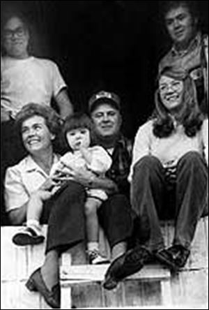 Mr. and Mrs. Miller surrounded by their children: Dave (clockwise from top left), Mick, Sandy, and Lori in her mother's lap.