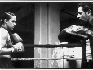 "Diana Guzman (Michelle Rodriguez) in the ring with Hector (Jaime Tirelli), her trainer, in Karyn Kusama's ""Girlfight""."