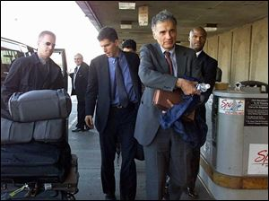 Green Party candidate Ralph Nader heads for a flight in Detroit. His support in Michigan may affect the presidential race.