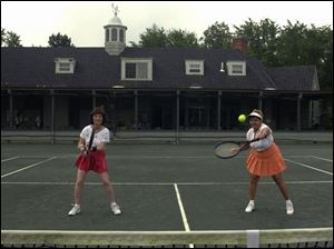 Phyllis Bernstein and Nancy Winsor play a doubles game at Toledo Tennis Club.