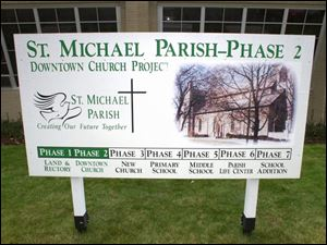 A sign outside St. Michael's Church on Findlay's east side gives a timeline for the work.