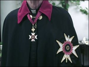 The Rev. John McClure in Knights of St. Catherine of Sinai cape and medallion.
