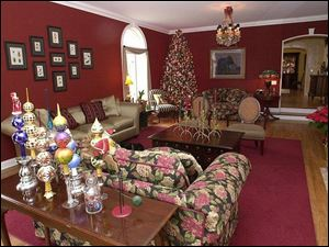 The living room of the Valko-Moore home is decorated with a collection of Christopher Radko finials and reindeer candlesticks.