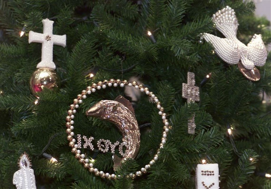 a stylized fish dove cross and candle are among the several hundred chrismon 2 handmade ornaments proclaim spiritual meaning of christmas