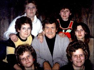<xh>Family members surround Bob Harmon, who has made Seneca County smile with his stories. From left are, in bottom row, twin daughters Andy and Sandy Harmon; in middle row, wife Arden, Bob, and daughter Cara Kelley; and in top row, daughters Shar Harmon and Erin Blake.