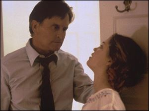 Michael Douglas and Erika Christensen in a scene from Traffic.