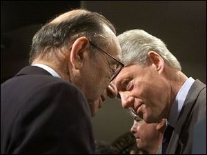 Federal Reserve Chairman Alan Greenspan helped the President to change the nation's basic economic outlook.