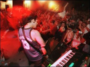 Crowds cheer wildly during a 1999 concert at the Main Event in East Toledo on Main Street.