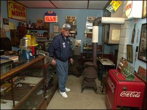 Mr. Wolfe keeps his collection of Sohio memorabilia on display in a replica of an old-time gas station, which he built himself just yards from his home in Eden Township. `If you need money, don't come here. Anything else, we might have,' he jokes.