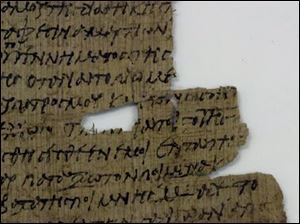 A papyrus fragment written in Koine Greek details the Last Supper and the Betrayal.