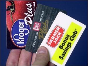 Kroger and Farmer Jack have joined Food Town, which introduced its cards in 1993.