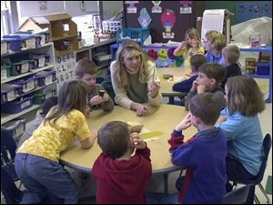 Jennifer Hare and kindergarteners at Douglas Road Elementary discuss vegetables before they prepare soup.