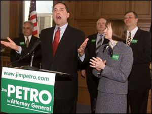 Jim Petro, second from left, announces his run for attorney general in the Lucas County Courthouse. With him, from left, are Hancock County Auditor Anthony Iriti, Lucas County GOP Chairman Patrick Kriner, Mr. Petro's wife, Nancy, and House Speaker Larry Householder.