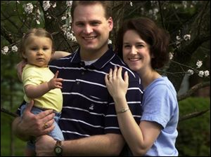 Jodie Tienvieri with her husband, Marc, and Hannah Grace, who was born just days before Mother's Day in 2000.
