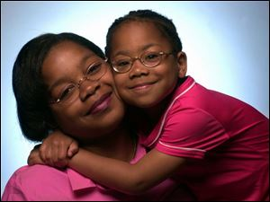 Charon Miller and her daughter, Imani. Since 1986, Ms. Miller has cared for Imani and received her bachelor's and master's degrees.