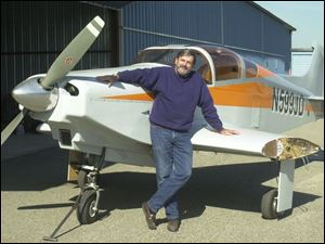 Jim Davis of Point Place built this experimental wooden plane in his garage.