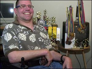 Dann Poling, surrounded by some of his awards, will be in the northwest Ohio delegation at the Special Olympics precursor.