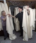 A-sacred-seamstress-Tiffin-woman-s-vestments-look-just-heavenly-on-priests-2