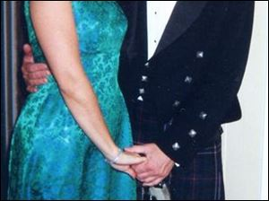 Ottawa Hills native and kilt-clad Robert Rand: shown here with his fiancee, Laura Watson.