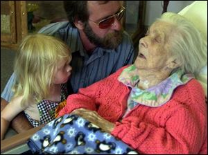 Jay Neusbaum pays a visit to his grandmother at her nursing home with his own granddaughter, Desiree Woodcox.