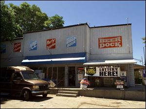 The Beer Dock, at Huron and Lagrange streets, is one of the vanishing breed of family-owned carryout markets.