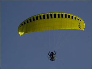 Don Jordan of Indiana takes to the skies over Perrysburg Township with his paraglider.