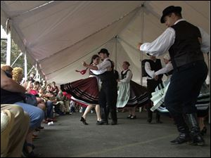 The Kodaly ensemble of Toronto performs Hungarian dances under a tent during the Birmingham Ethnic Festival.