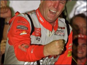 Sterling Marlin celebrates his win after NASCAR officials called off the race on Lap 162 because of rain. Marlin won $157,830.