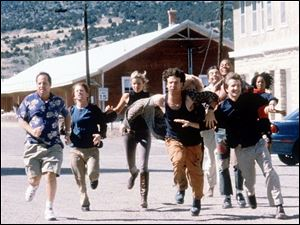 "Jon Lovitz, from left, Seth Green, Amy Smart, Vince Vieluf, Whoopi Goldberg, Rowan Atkinson, Cuba Gooding Jr., Breckin Meyer and Lanai Chapman in a scene from the motion picture, ""Rat Race."""