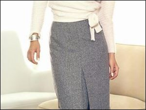 Zanella's wool and angora wrap sweater with belt is paired with a long tweed skirt.