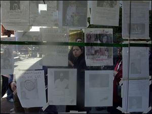 A bus kiosk becomes a wall of 'missing persons' posters near St. Vincent's Catholic Medical Center in New York City. Thousands of people are missing in the rubble of the trade center.