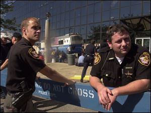 Lucas County sheriff's deputies Steve Gadoury, left, and Steve Meehan, outside the Jacob Javits Conference Center, were almost overwhelmed by the sight of the death and destruction.