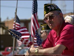 Veteran Hubert Grothouse watches the parade pass by as part of Canal Days in Delphos.
