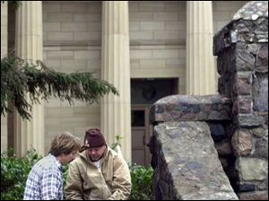 Paul Berringer, left, and Tom Lafever look over stones from gate pillars being rebuilt at the Hayes Presidential Center in Fremont.