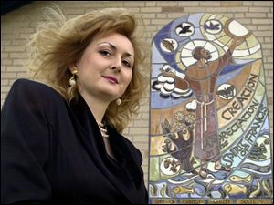 Svetlana Cholvadova's ceramic murals include this four-foot-by-six-foot tribute to St. Francis of Assisi on display at Lourdes College in Sylvania.