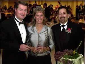A VINE TIME: From left, Steve and Gwen Mickus, honorary chairmen, and Rob Snoad, chairman, sample some fine wine during the gala at the Stranahan Great Hall.