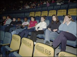 From left, Kellie Roberts, Deb Essing, Stephen Davis, Robert Oliver, Jasmine Boyd, Melaniya Woodward, Delaney and Casey Mahoney, and Meredith Tong, wait for the film to start.
