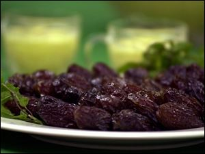 Dates are eaten to break the fast, and Mango Lassi, background, is a favorite in Pakistan.