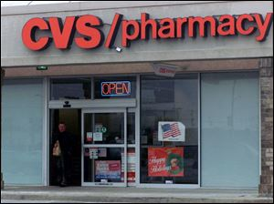 This CVS store at 5860 Lewis Ave. is one of four in the Toledo area that will be bought and renamed by the Rite Aid chain.
