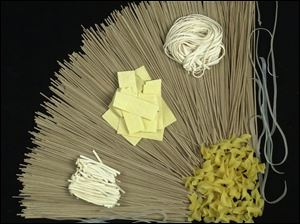 Types of noodles include soba (background), traditional egg (lower right covner), and clockwise from left, Asian bean, Hungarian, and Asian wheat.