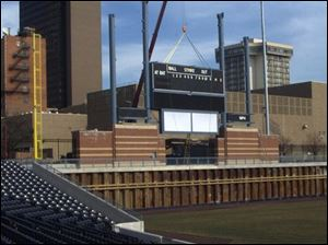 A section of the scoreboard is lowered into place at the Mud Hens' new home, Fifth Third Field.