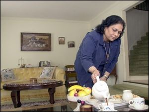 Usha Mohan serves tea at her Ottawa Hills home. Although her first 20 doses of H11 seemed to help, a new ovarian tumor grew while she completed her second round of treatment.