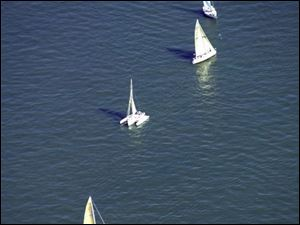 Sailboats compete in the Mills Trophy Race from Harbor Light to Put-in-Bay in June. Abou