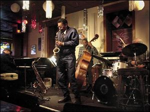 Murphy's is one of the places to find live music in downtown Toledo. Larry Smith on the alto saxophone sits in on a set with Bob White on the drums; Claude Black, piano, and Clifford Murphy, bass.