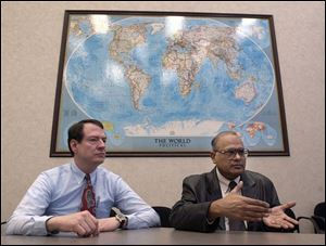 Lee Springer, left, and Vinod Jain, at the Regional Growth Partnership headquarters, work toward increasing the area's trade with the world.