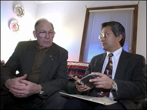 Wayne Matter, left, learns about the diary from Joseph Hara, a professor of Japanese at the University of Toledo who translated portions of it.