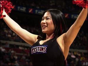 Jen Tserng, photographed at a recent Pistons game, says dancing is something fun to do in her spare time.
