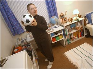 Aaron Bar, 13, at his home, is able to walk again as a result of corrective surgery through the Shriners organization.