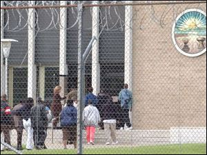 A large group of family members enters the Southern Ohio Correctional Facility.
